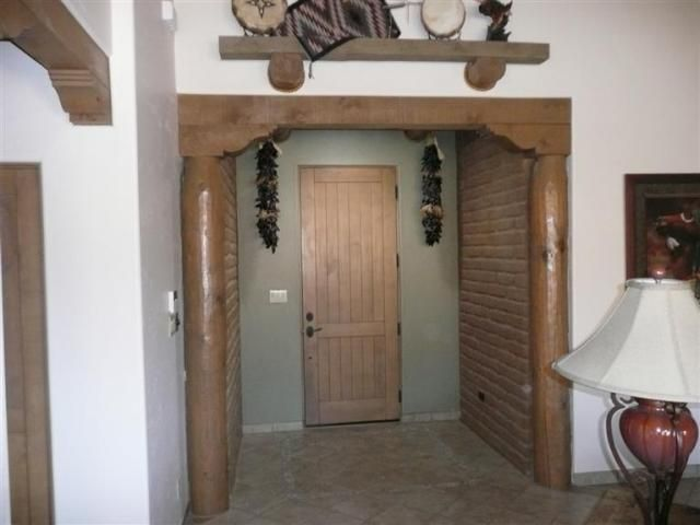 Entry with lighted solar tube and adobe walls