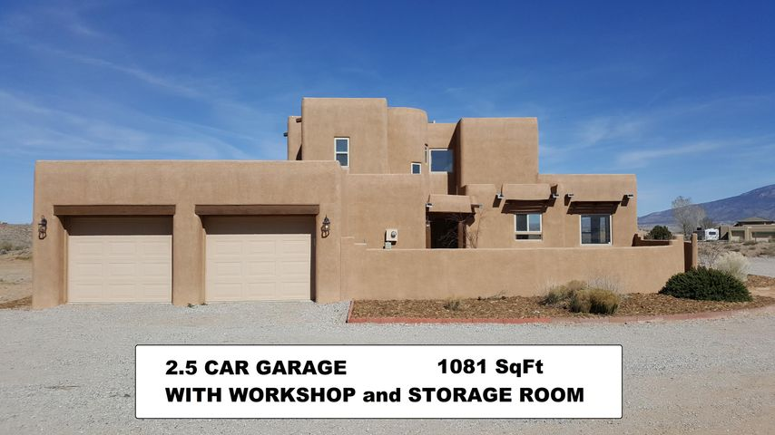Two and Half Car Garage with Storage and work shop area