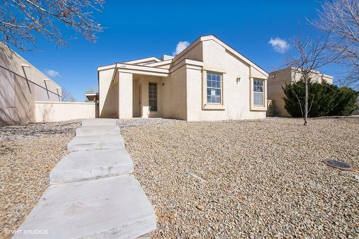 Beautiful two bedroom, two bath home located in the heart of Rio Rancho. Spacious livng room with elegant windows, kitchen offers plenty of cabinet space, master bedroom has a large mirror closet door and access to a private outdoor sitting area. Covered patio and two car garage with workspace and more. Dont miss out!!