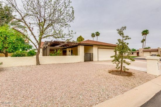 Larger corner lot with easy care yard.