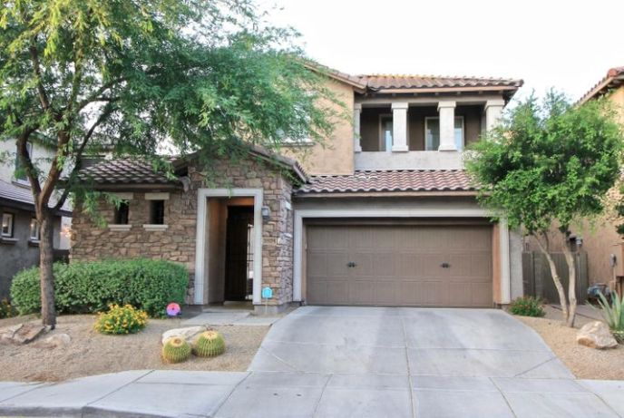 Beautiful Desert Ridge home with 4 bedrooms, 2.5 bathrooms, with a downstairs den/office & upstairs loft, and just under 3,000 square feet.
