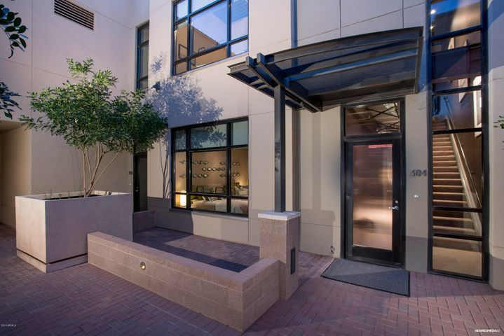 Plaza Residence 305 has its own Front Entry and Courtyard to create identity even before you walk in.....