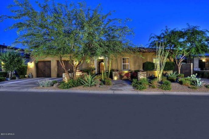 Courtyard Entry with beautiful landscape and colorful plants, easy care, low water use.