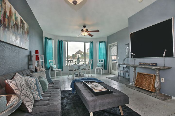 Living room has views of A Mountain and downtown Tempe