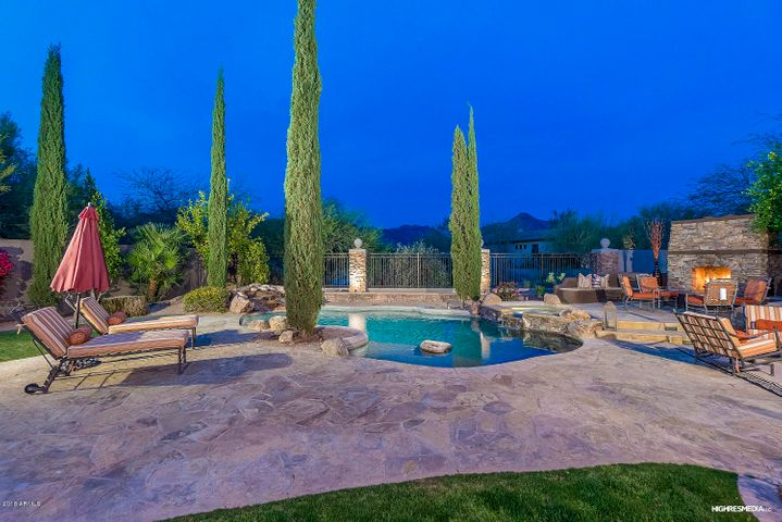 Relax or entertain in this exquisite backyard with a resort side featuring views, pool, spa, fireplace, and BBQ and a sport side featuring a sport court and in ground trampoline.