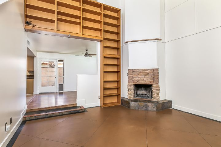 Living Room with fireplace and bookcases.