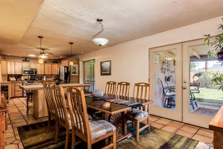 Open living area with newer french doors to the back yard