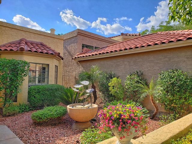 Impeccable Entry provides a fitting welcome to this meticulously maintained and decorated home