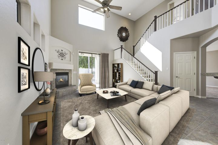 Virtual Staging showcases the family rooms soaring ceilings, staircase and fireplace.