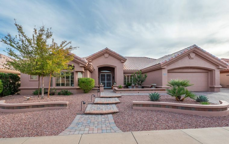 Beautiful Curb View With Updated Landscaping and Paved Walk