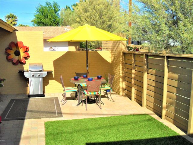 unit 104 private backyard with pavers and synthetic turf for your pup