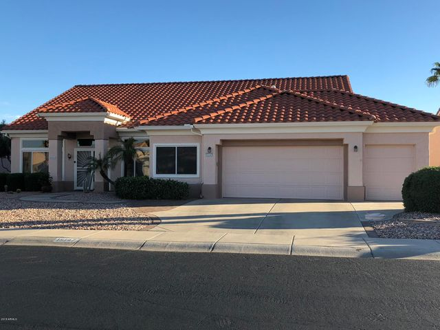 Great curb appeal and an extended golf cart garage!