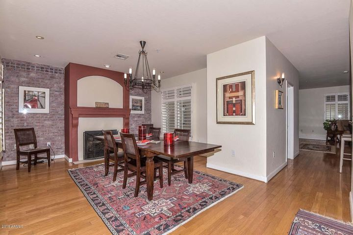 cozy fireplace and hardwood floors