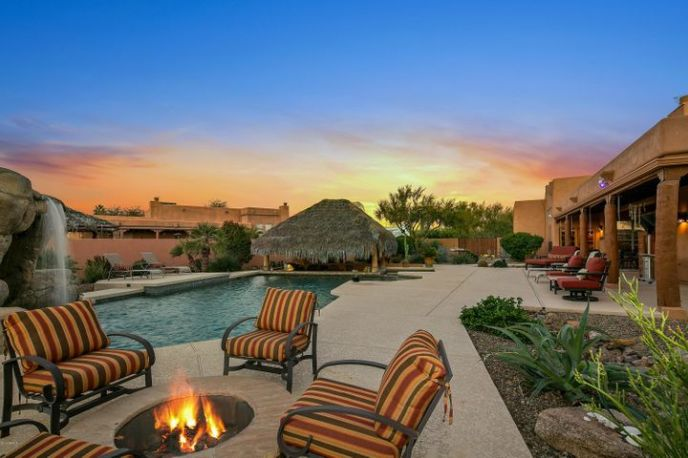 Relax and enjoy a beautiful AZ sunset in this resort like backyard complete with pool, spa, firepit, 13' waterfall, and palapa/ramada with swim up bar.