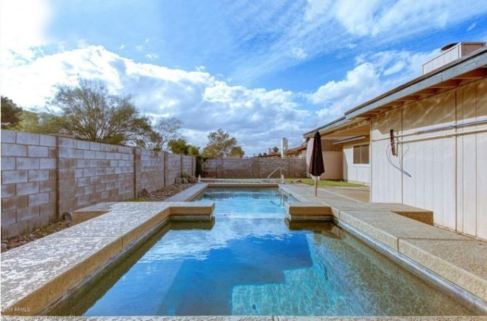 Lengthy sparking pool and overflowing spa! Perfect for year round backyard entertaining.