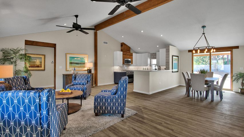 Great room concept with raised ceilings and beams ideal for entertaining