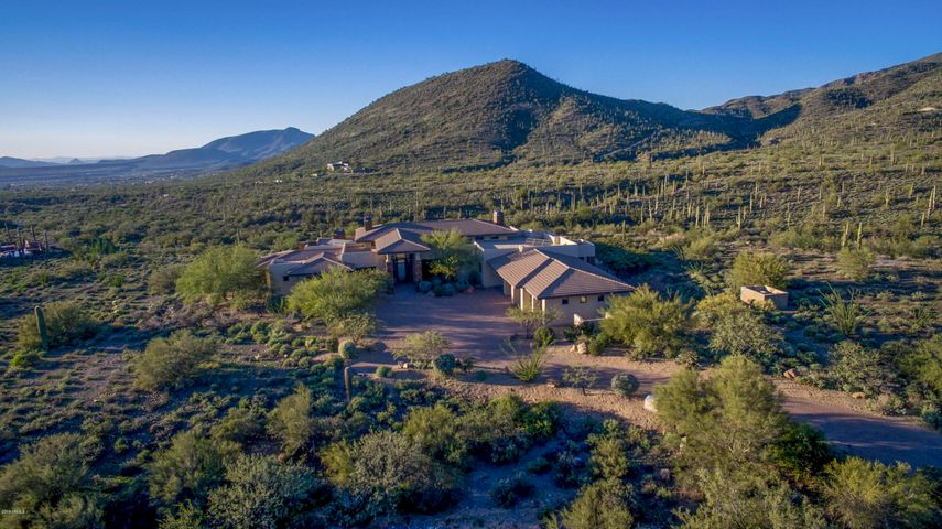 This gated Grapevine Rd estate has over 7 1/2 acres of land and has 58,000 sq. ft that can be disturbed. Plenty of room for an area, mare motel, RV and car storage, casita. You name it and there is no HOA. Super private and quiet!