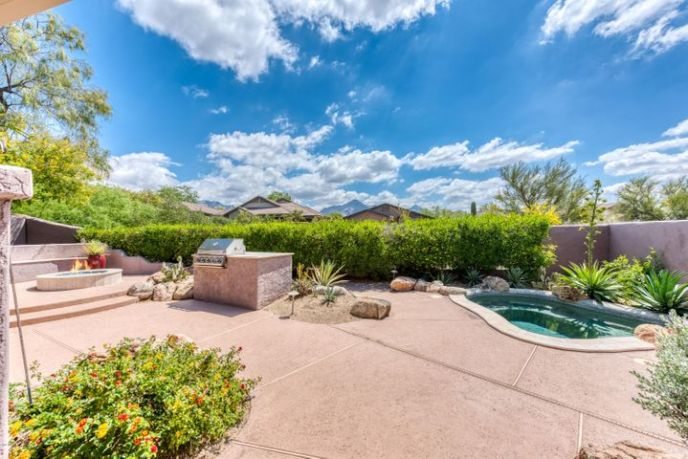 Private backyard with spool, built in BBQ, gas firepit