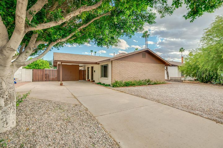 Features carport, another 1 slab parking, an extended drive-way and RV gate
