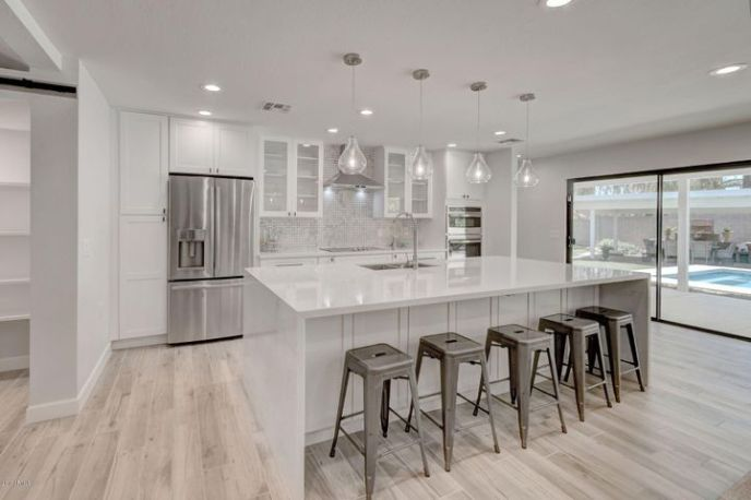 This home has been completely re-designed- updated & modern feel: The chef's kitchen is perfect for entertaining! Stylish white cabinets, quartz counters w/ large waterfall island, large pantry & new stainless appliances, lighting and fixtures!