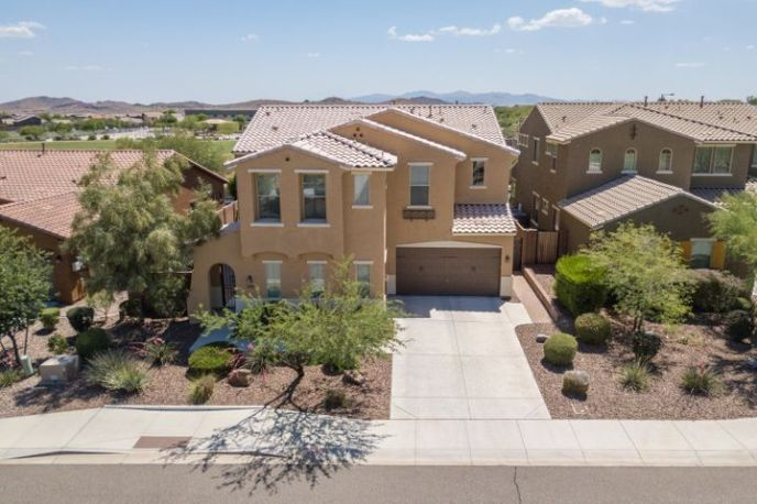 Welcome Home to the highly upgraded Taylor Morrison Revere model, situiated on a premium lot with Mountain views, backing HOA owned and maintained land.