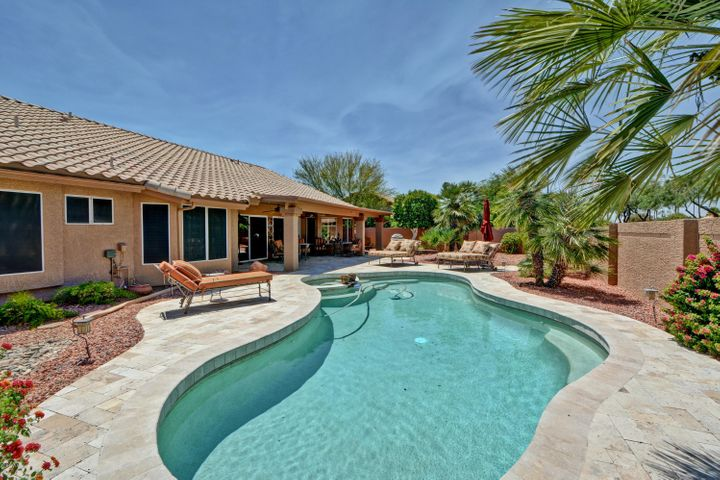 Backyard boasts a private pool and spa surrounded by travertine pavers. This is a true entertainers dream!