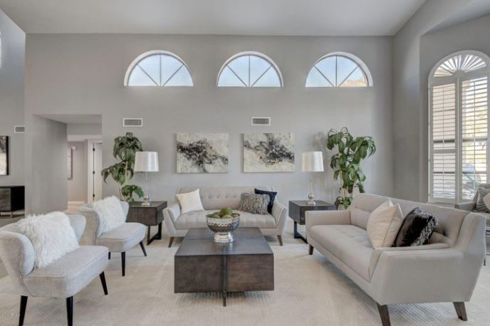 Lots of natural light with large windows and beautiful shutters