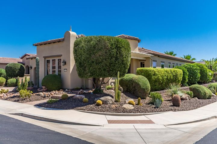 Welcome Home! Located on Corner lot with lush landscaping and private yard.