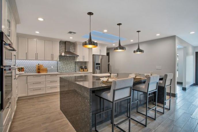 Designed with trendy colors, modern finishes and Restoration Hardware pendants the kitchen is light and bright.