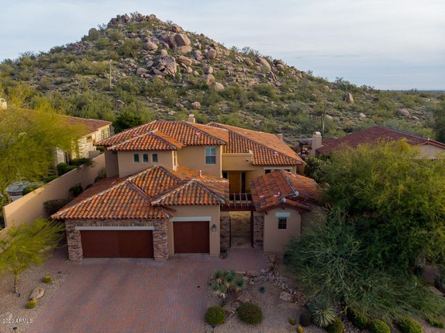 Backing to mountain with an ancient boulder outcropping as a backdrop, welcome to the exclusive gated community of Las Piedras at Sevano Village in North Scottsdale, conveniently located near high-end services/shopping.