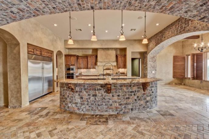 Large open kitchen, double built-in refrigerators, double islands, opens to the great room.