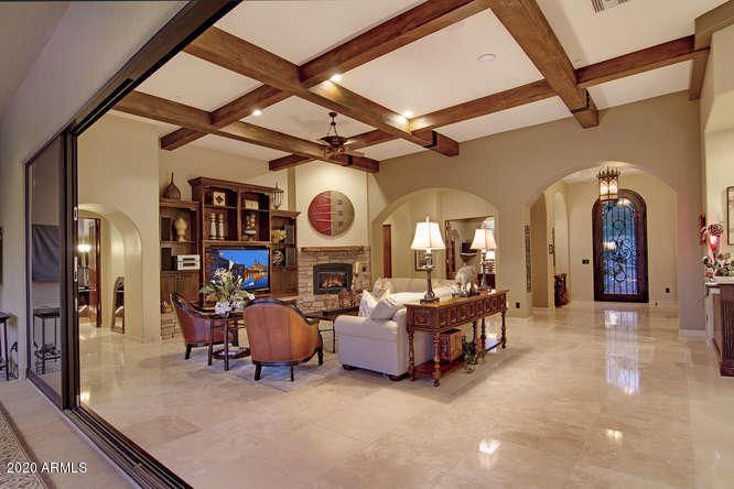 HUGE Great room with beamed ceiling, polished stone flooring, fireplace. Collapsible wall of glass bring the outdoors inside.