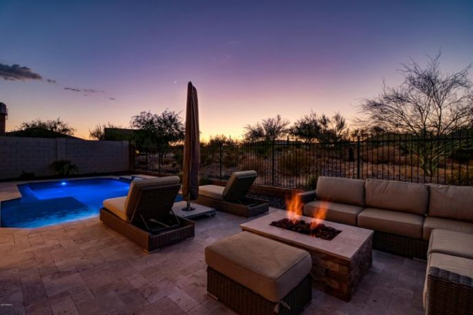 Welcome home to this picturesque 3 bed + Den, 3.5 bath single level home in the prestigious Blackstone at Vistancia community in North Peoria, AZ.