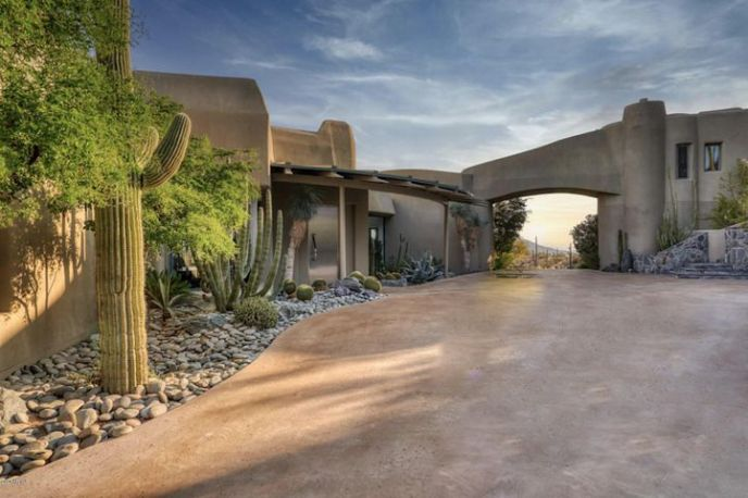 WELCOME HOME! YOU ENTER YOUR RETREAT ON 12 ACRES THROUGH AN ARCHITECTURL ARCHWAY. THIS ORGANIC DESERT CONTEMPORARY HOME OFFERS A MAIN HOME (5749 SQ. FT.) WITH 2 MASTER BEDROOM SUITES & A DETACHED GUEST HOUSE (965 SQ. FT.)