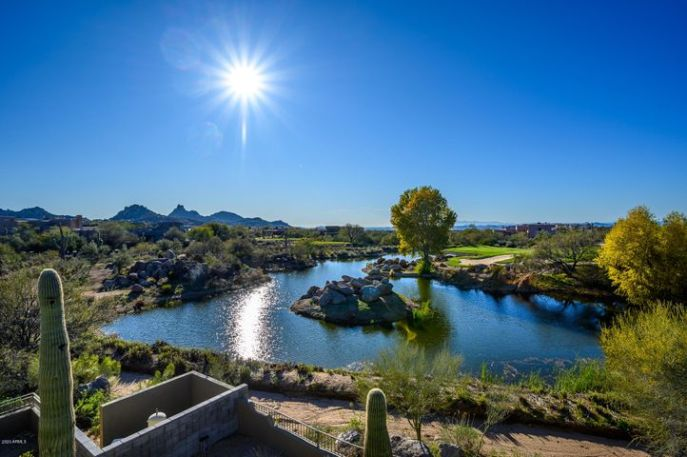 Imagine the ever changing portrait of Pinnacle Peak, sunsets and city lights, while overlooking the lake and the 16th hole of the Pinnacle Course at Troon North Golf Course.