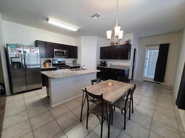Spacious eat in Kitchen with lots of counter space, granite countertops, espresso cabinets and stainless steel appliance