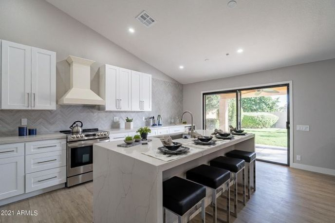 Beautiful Quartz Counters, White Shaker Cabinets and SS Appliances