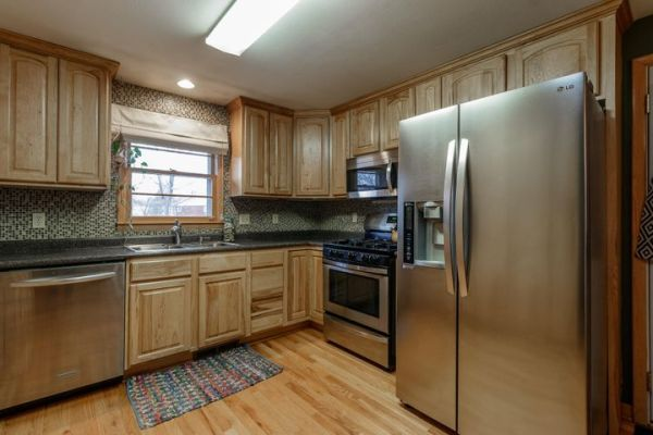 Updated appliances, (new gas range and newer dishwasher)cabinets/countertops.