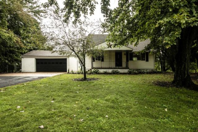 Vinyl exterior, asphalt drive sealed ~09/2018, pond, rolling wooded lot, new stained deck ~2014, new doors & trim ~2016, new insulated windows ~2010, covered front porch, yard shed, barn, septic system