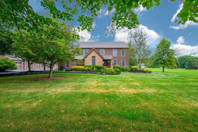 Fantastic Custom 4 Bedroom with a Brand New 5-Car Garage on over 2 Acres in Dublin Schools.