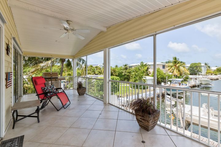 Spacious upper level screened porch over looking the canal.