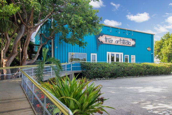 200 ft. frontage on Overseas Highway. Heavy duty insulated steel reinforced building with handicap access to the first floor. Metal roof. Impact windows and doors. Raised elevation. No hurricane worries here.