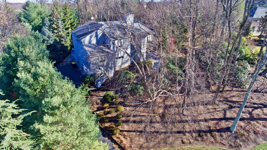 Aerial View of Wooded property.