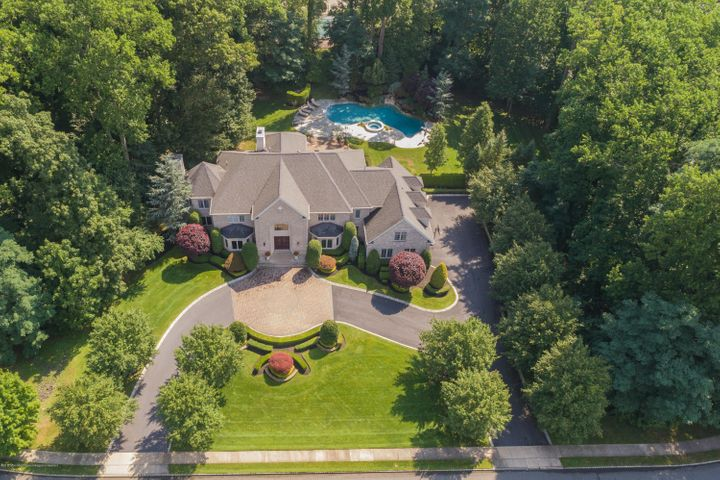 Aerial View of 2.5 Acres asphalt/paver driveway, pool, paver patio