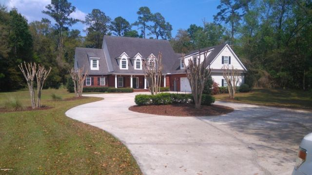 Home sits back off the road and has 200' +/- circle driveway with extra parking