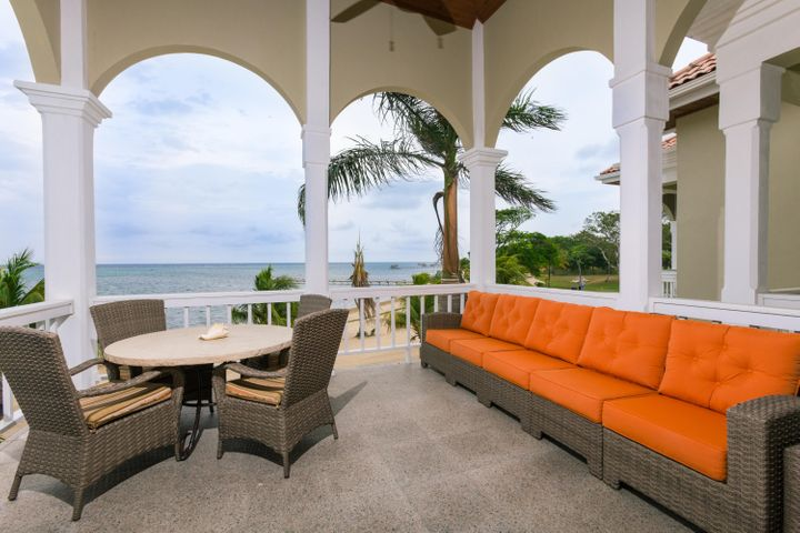 Exterior terrace overlooks the white sand beaches and Caribbean sea