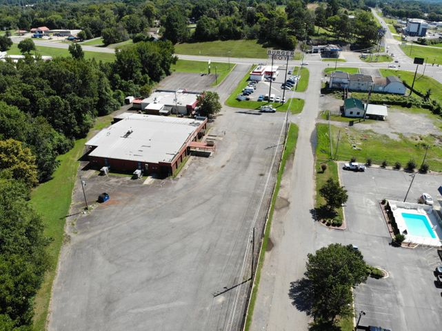 With I-40 visibility and Hwy 7 frontage, these 2 commercial buildings are located in one of the highest traffic count areas in Russellville. With over 5.5 acres and 18,000sqft combined, business development possibilities are endless.