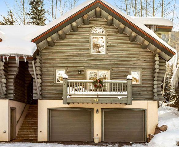 A True ski chalet minutes from Vail Village.Made with Montana logs,this unique property lives like a single family house with no shared walls.Exceptional highlights are vaulted ceilings,mountain views,enormous 2 car garage,fenced private back patio.Located in unique,peaceful,private enclave.Turn key, perfectly refreshed-New slab quartz counter tops,Newly sanded Pine Plank floors,both exterior/ interior Freshly Painted/stained,New roof.A rental GOLDMINE-tenants permitted to have pets.Broker/Owner