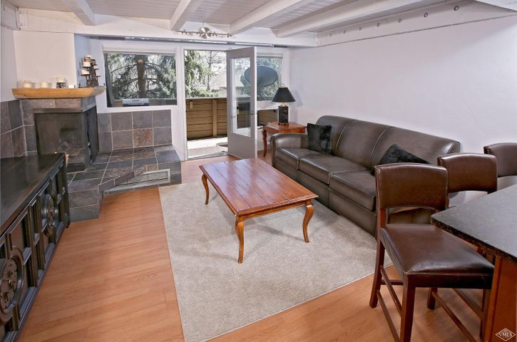 Located in Sandstone, enjoy the sun rise over the ski slopes from this 2-bed condo remodeled in 2017. Modern flair and special details to include sustainable blue pine throughout, granite counters, new cabinets, marble and porcelain bath accents, built-in shelving, large owners-closet, dimmer switches and black-out window shades. Mature trees for privacy, as the Sellers say like living in a treehouse. On the Town bus system. No stairs to entry from parking. Furniture negotiable.