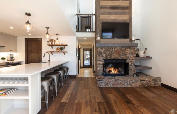 Beautifully remodeled Courtside Townhome, by Basso Interiors, located on East Vail bus route. This home has 3 bedrooms plus a fun bonus loft playroom, vaulted ceilings in the main floor living area, and an open kitchen, dining room and living room, perfect for entertaining. Enjoy the sounds of the creek out the back door.